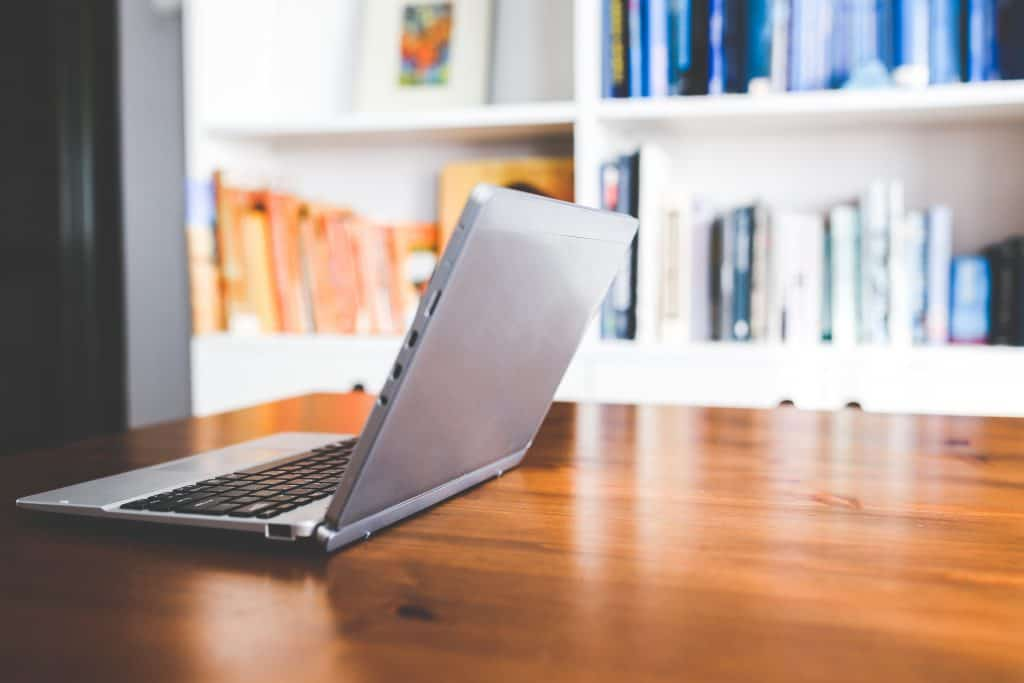 Laptop-computer-on-a-wooden-desk-1024x683